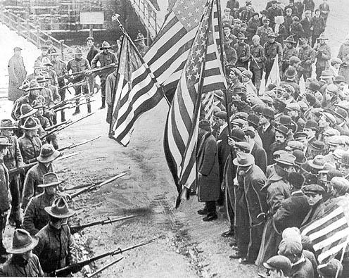 Massachusetts militiamen with fixed bayonets surround a group of strikers during the Lawrence, Massachusetts Textile Strike of 1912