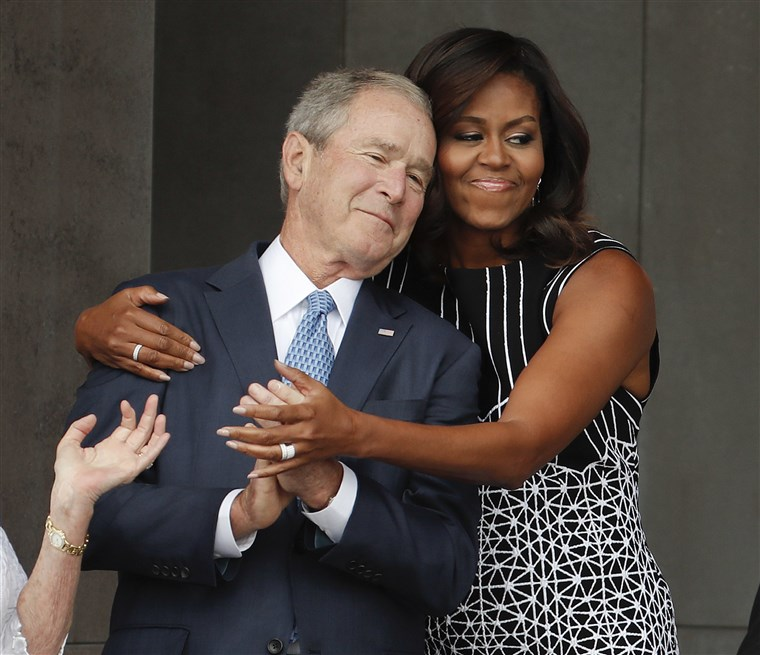 Michelle Obama hugging George W Bush