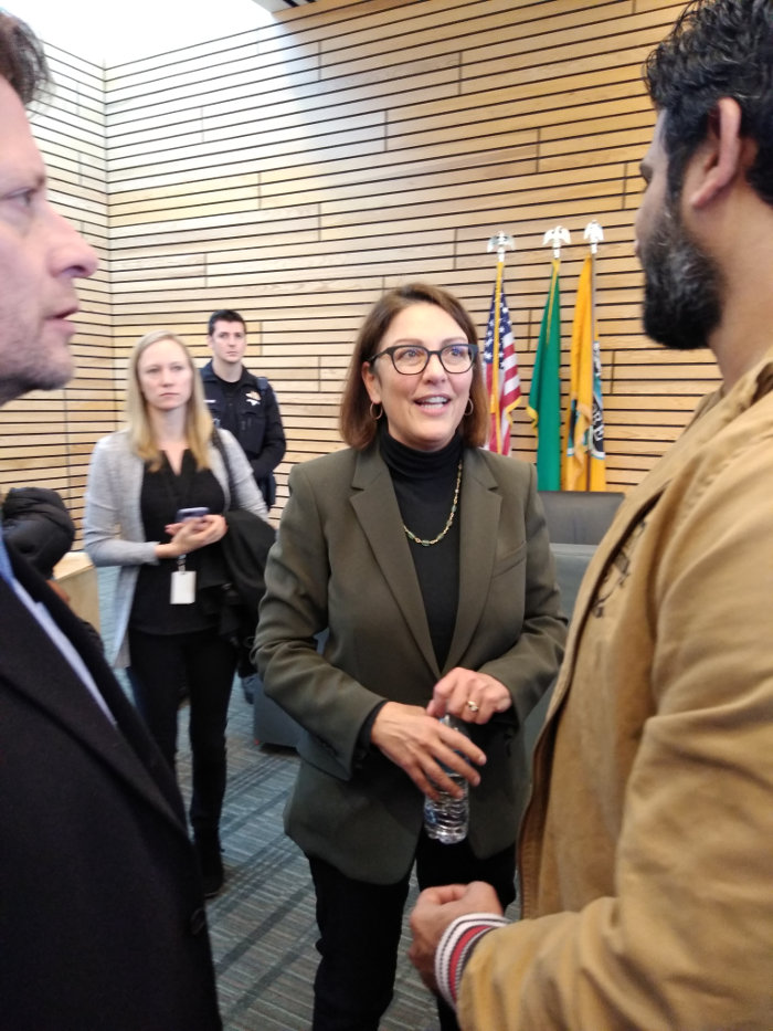 Rep. Suzan DelBene speaking with a constituent on Nov 11, 2019 at a town hall in Kenmore, WA